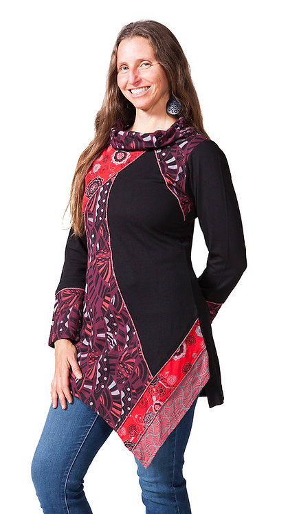 Model wearing long cowl neck tunic-long sleeves-asymmetrical handkerchief hem-part solid black, part red print