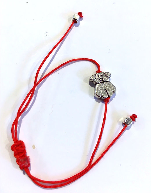 metal dog charm bracelet on adjustable knotted red cord with silver beads at ends