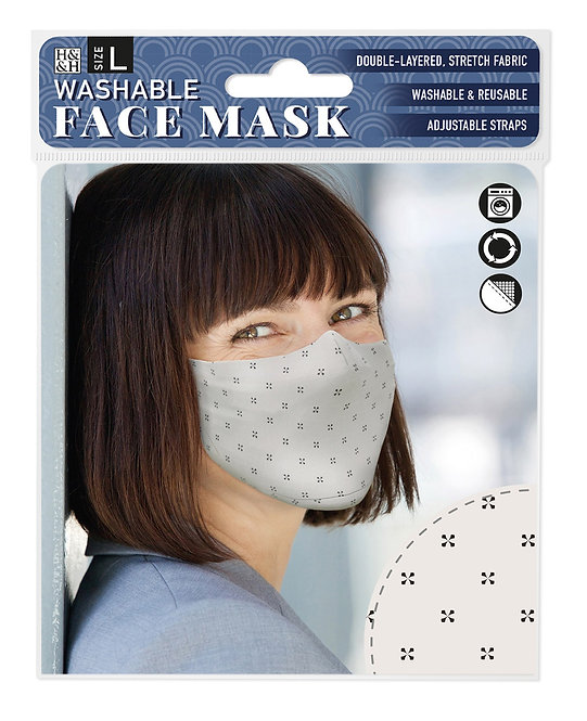 Packaging showing model wearing cream mask with tiny black cross pattern