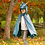 Front view of child wearing shimmering blue-gold dragon cape with hood & scales