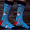 Pair of feet wearng Bright blue men's crew socks printed with red maple leaves and bowls of poutine
