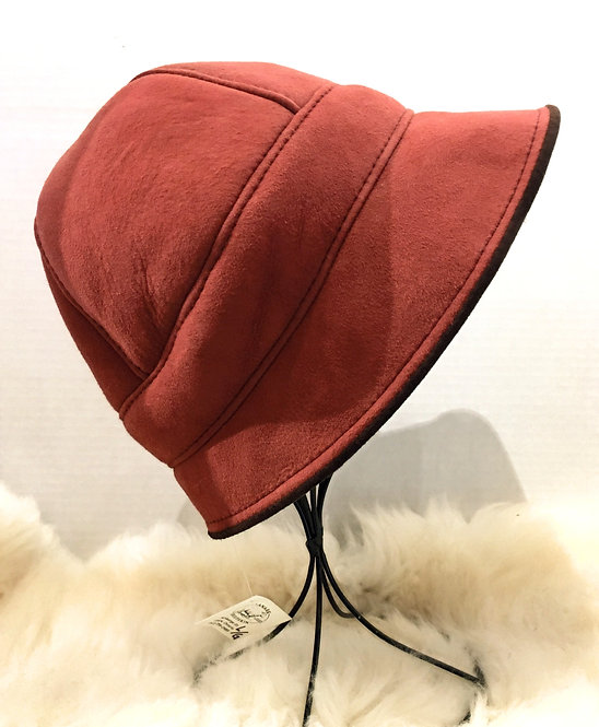 Right view of red Zelda paneled sheepskin hat with small peaked brim