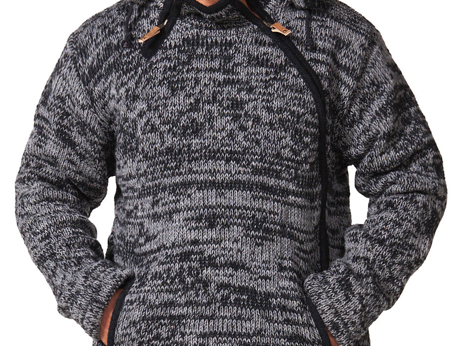 Front of model wearing heavy knit wool cardigan black-gray blend-angled side zip-2 front pockets-detachable drawstring hood