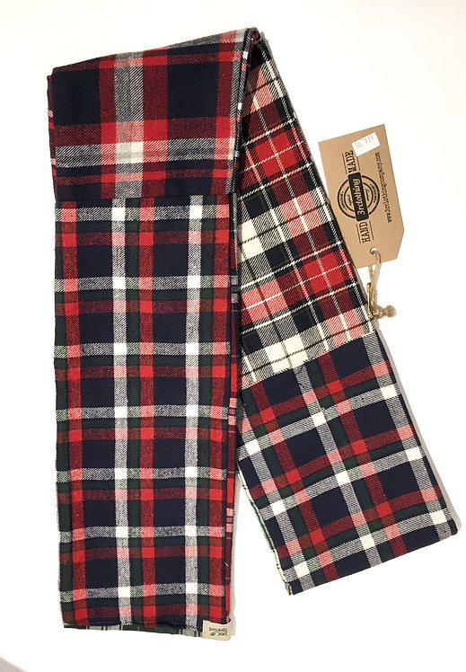 Side 1 of double sided patch flannel scarf, mostly red, white & blue plaids