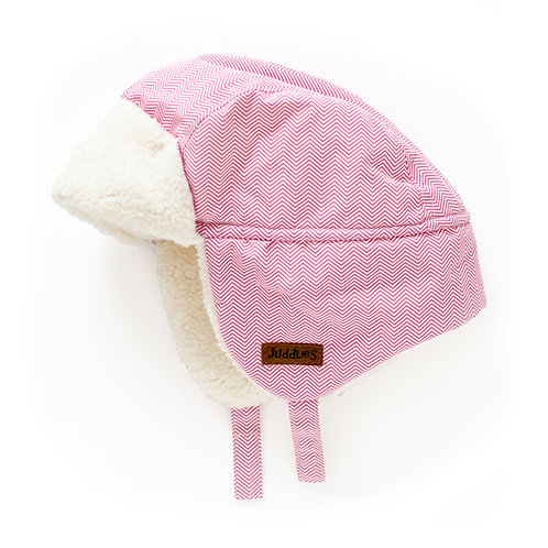 Side view of pink herringbone baby pilot hat with off-white fleece lining