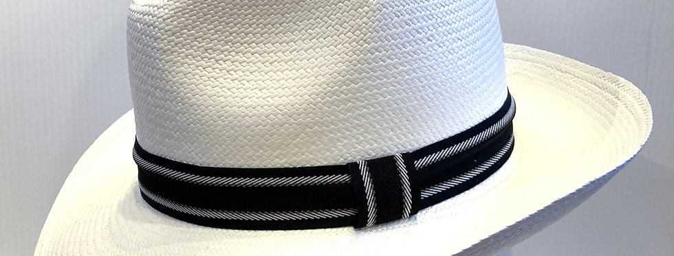 Side view of white Panama Hat with black band with 2 white stripes
