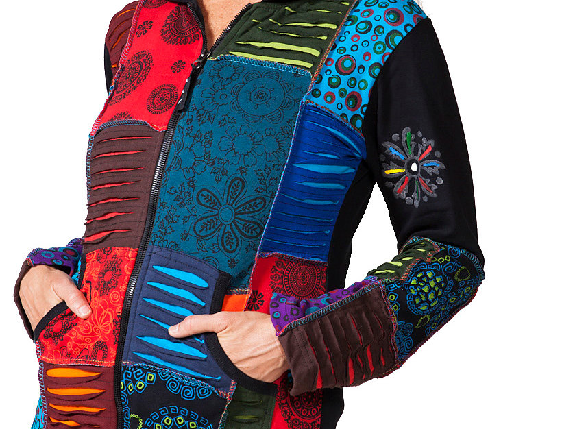 Model wearing Magnifique Zip Hoody, multi-coloured patches alternating mandala print and rip torn look, 2 front pockets