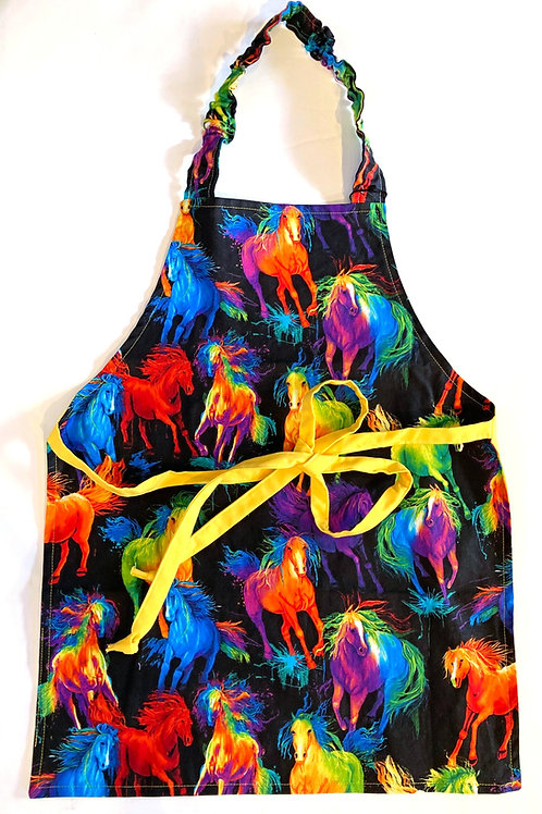 Front view of child's apron - vividly colorful horses cavort on black background