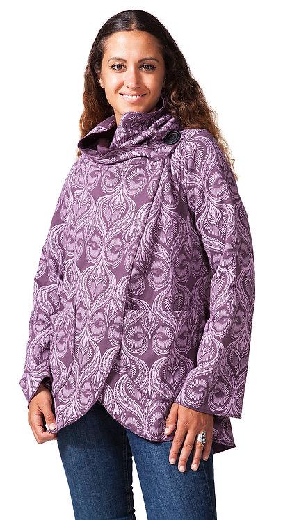 angled side view of model wearing long sleeved hooded jacket-side closure on shoulder-plum