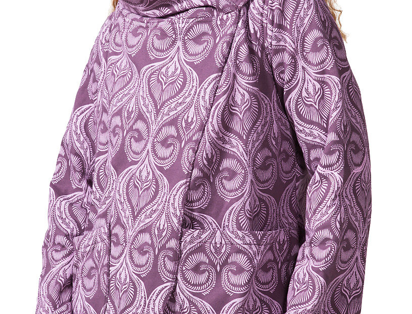 angled side view of model wearing long sleeved hooded jacket-side closure on shoulder-plum