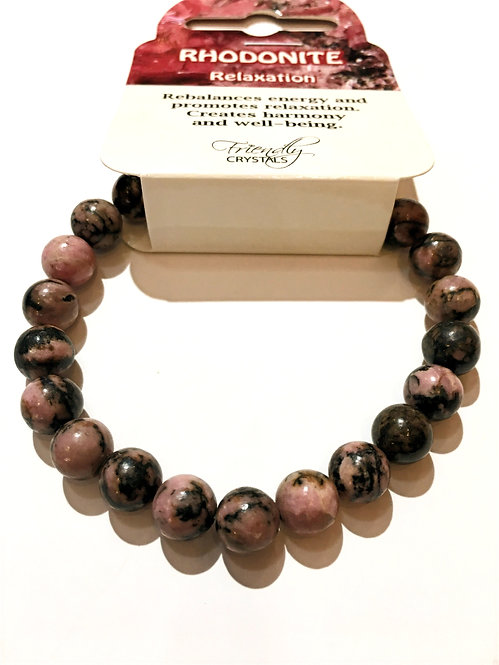 Close up of rhodonite stone bead stretch bracelet