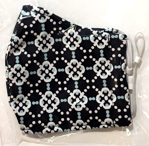 close up of kids cotton protective mask-black with geometric print of white dots