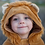 Child wearing Great Pretenders Toddler Lion Cape close up