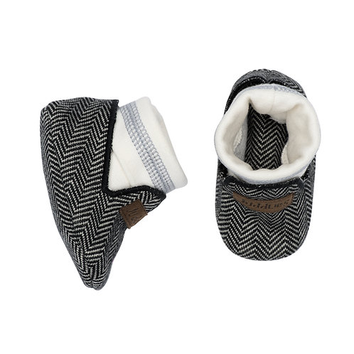 Top view of black herringbone baby slippers with white band & gray stripe around ankle