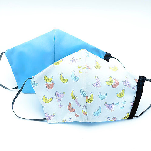2 protective masks showing pastel chicks on white background one side-plain sky blue the other
