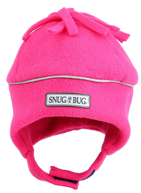 front view of solid pink fleece hat with silver reflective piping around crown-chin strap-fleece tassels on top