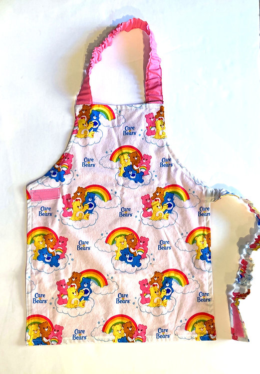 Front view of child's apron - rainbows & Care Bears print