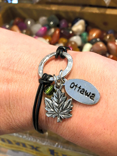 Basic Spirit Pewter & leather bracelet with maple leaf & Ottawa charms on a wrist