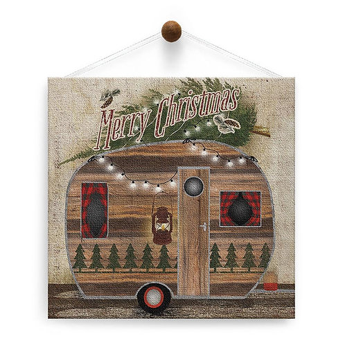 Square card pic of little wooden camper trailer with tree on top text 'Merry Christmas' hanging from a thumbtack