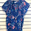 Front view of navy floral print short sleeve pullover blouse