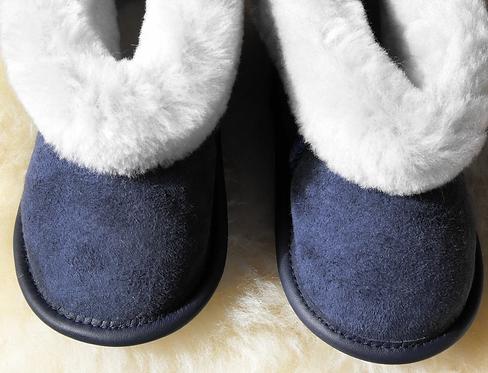 Front view of kids denim sheepskin slipper with white cuffs
