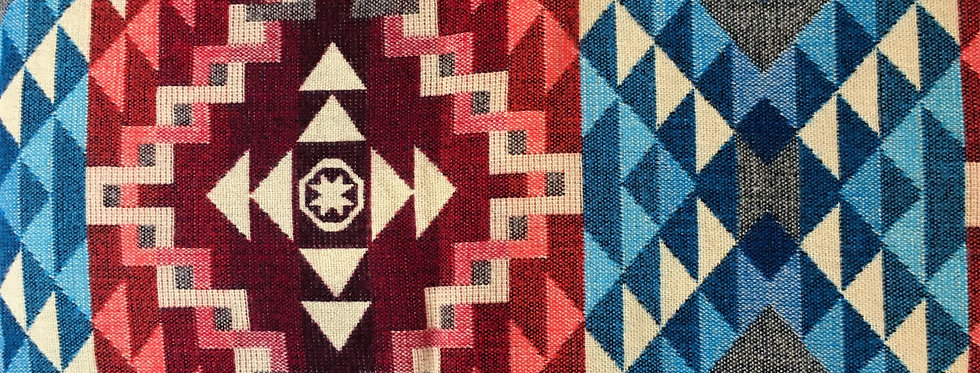 Close up of red geometric patterned blanket