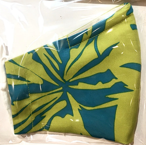 Close up of lime & teal print mask folded in half in plastic