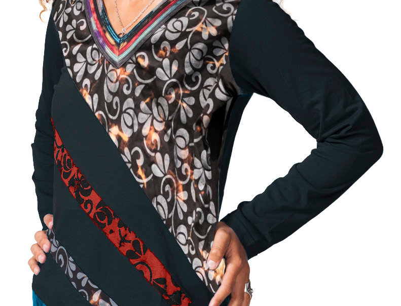 Model wearing long black V-neck tunic-long sleeves-diagonal stripes of appliques fabric in red teal purple gray-floral print