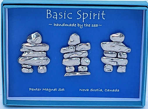 Open Blue box containing set of 3 pewter magnets in the shape of inukshuks