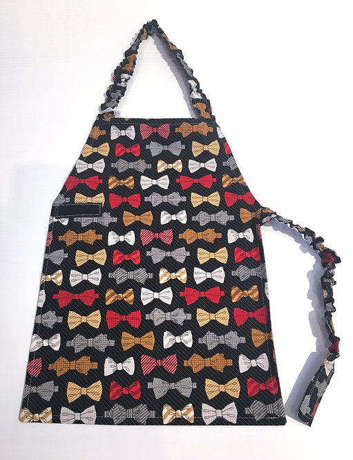 Front view of child's apron - black with gray pinstripe background with red, gold & gray sriped bows