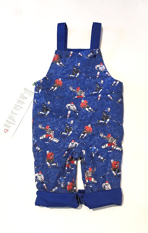 Blue reversible child's overalls with hockey players print - cuffed