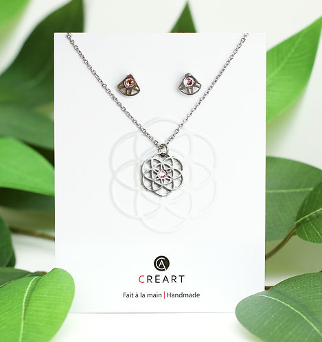 Green & white card displaying pewter chain, pendant and stud earrings set in flower shape