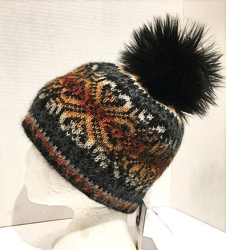 Wool toque with orange & yellow pattern with grays & black pompom