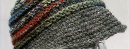 Gray chunky-knit wool hat with raised ridges of blue, white & orange, curled brim turns up in back