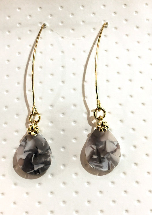 Pair of long tear drop-shaped tortoise shell earrings with gold ear wires