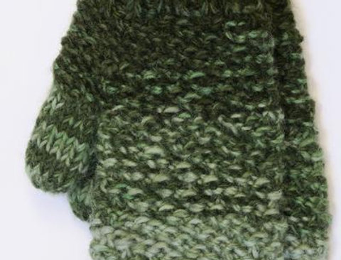 Green wool mitts knit in diagonal rib pattern