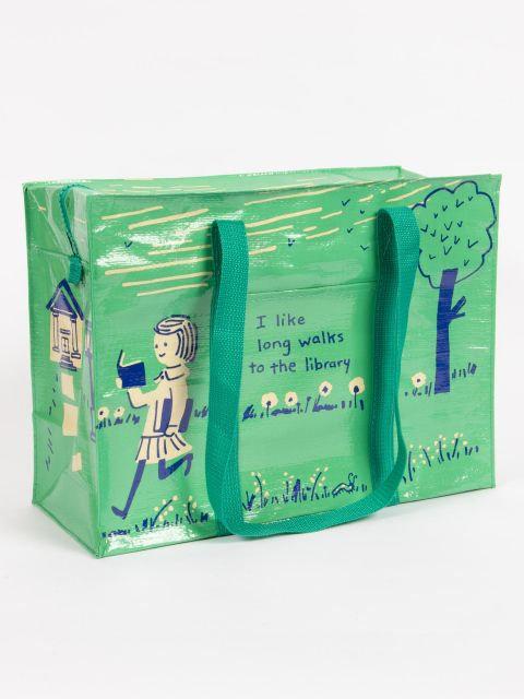 """front view of mint green roomy shoulder tote-image of girl walking & reading a book & text""""I like long walks to the library'."""