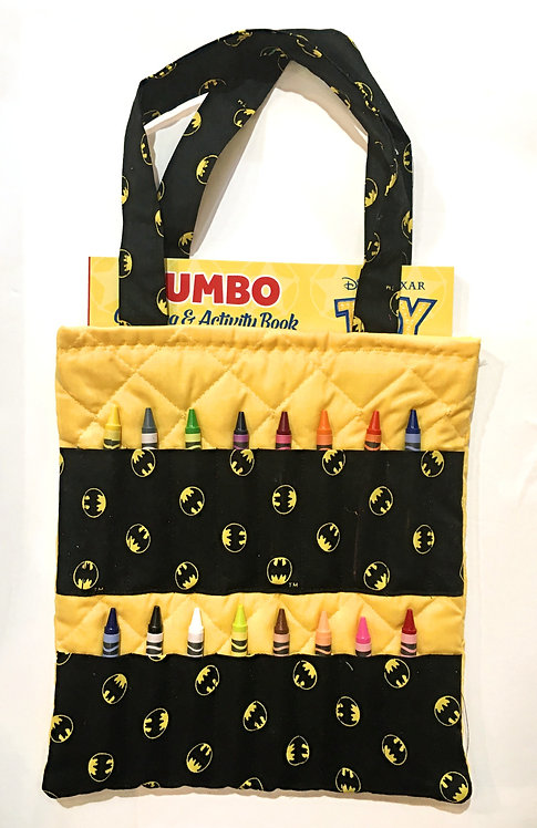 Flat rectangular yellow cotton tote bag holding a coloring book & 16 slots for crayons on the front