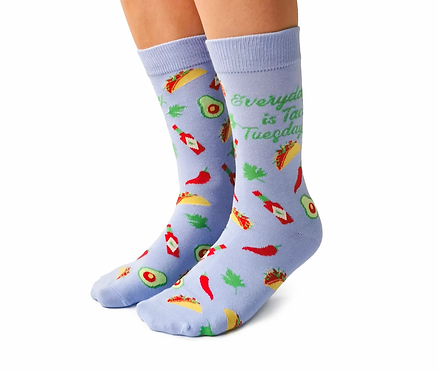 Left view of feet wearing blue socks with red & yellow images of tacos-Print on Socks 'Everyday is Taco Tuesday'