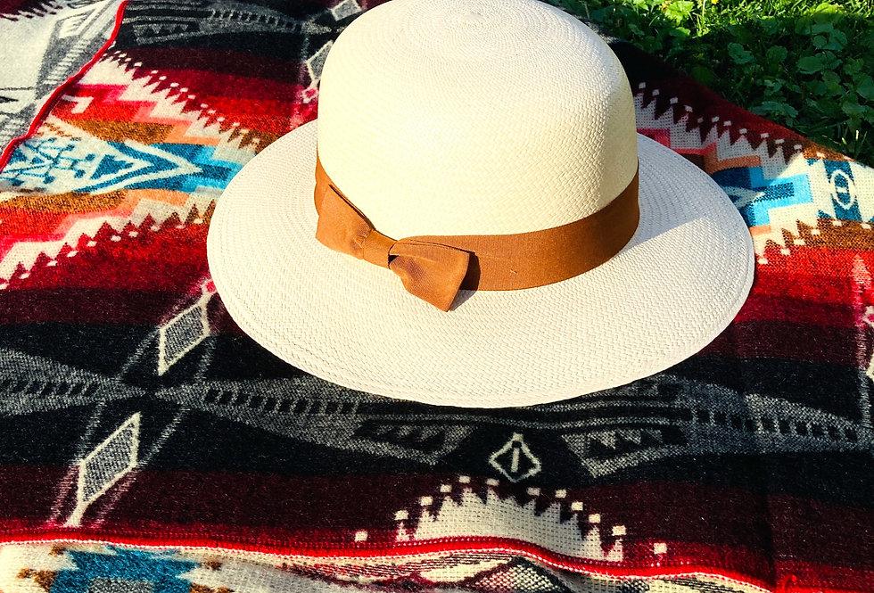 Natural campana panama hat on colorful blanket