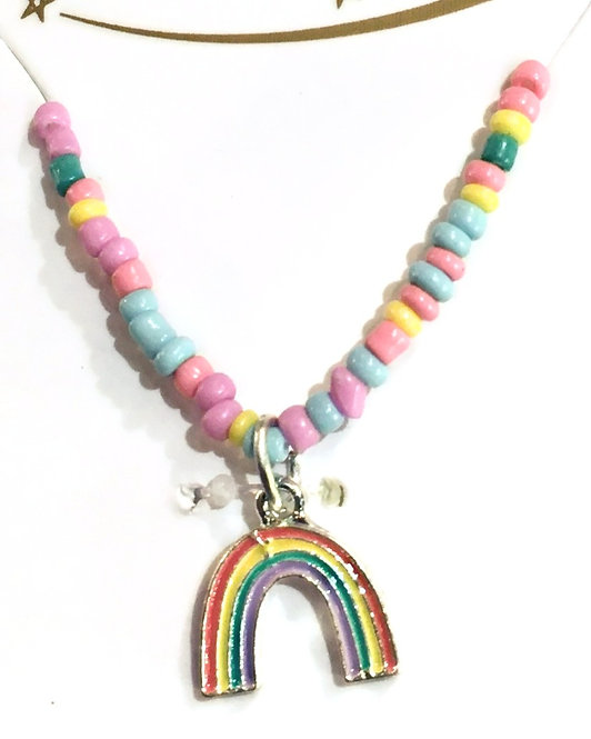 Close-up of child's dress-up necklace of multi-colored pastel beads with enamel rainbow pendant