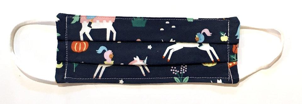 Tiny navy blue cotton mask laid flat with print of pony-tailed princesses on unicorns, stars & pumpkins