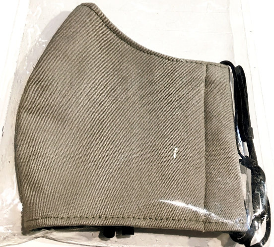 Close up of pale khaki cotton protective mask folded in half