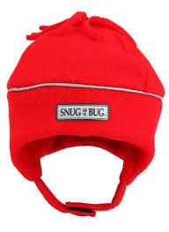 front view of solid red fleece hat with silver reflective piping around crown-chin strap-fleece tassels on top