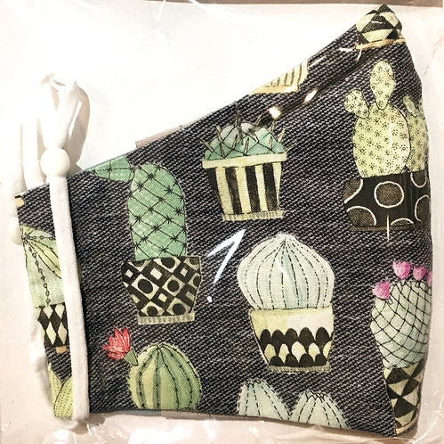 Close up of black mask with cactus print folded in half in plastic