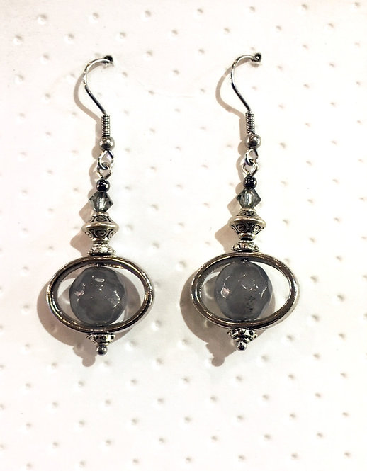 Pair of platinum-colored earrings with 10mm round gray quartz stones
