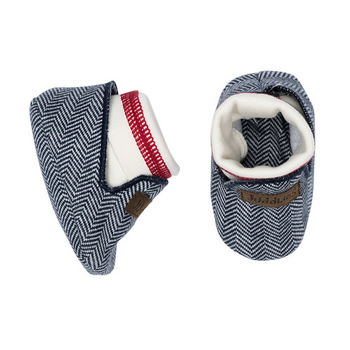 Top view of dark blue herringbone baby slippers with white band & red stripe around ankle