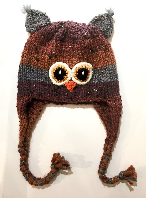 Brown & gray knit childs hat with earflaps & chin ties-owl eyes & beak stitched on-ear tassels at top of crown