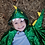 Front view of child wearing green & yellow Dragon Cape