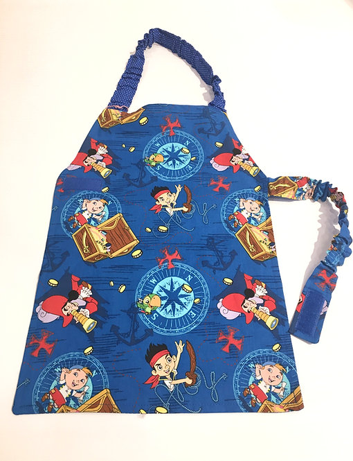 Front view of child's apron - blue with red & yellow pirates & compasses print